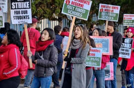 Striking Los Angeles Unified District teachers are joined by parents and students in front of Evelyn Thurman Gratts Elementary School in Los Angeles, Jan. 22, 2019. A tentative deal was reached Tuesday.
