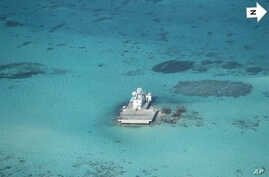 In this photo taken Feb. 28, 2013 by a surveillance plane, and released Thursday, May 15, 2014, by the Philippine Department of Foreign Affairs, Chinese-made structures stands on the Johnson Reef, called Mabini by the Philippines and Chigua by China,...