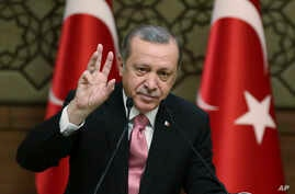 """Turkey's President Recep Tayyip Erdogan gestures as he addresses local administrators, in Ankara, Turkey, Wednesday, Feb. 8, 2017. In a sign of ameliorating ties, Turkish officials said Wednesday that U.S. President Donald Trump looked """"positively"""" o"""