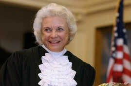 FILE - U.S. Supreme Court Justice Sandra Day O'Connor is shown before administering the oath of office to members of the Texas Supreme Court in Austin, Texas, Jan. 6, 2003.