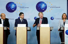 Britain's Foreign Secretary Boris Johnson attends a news conference with French FM Le Drian, German counterpart Sigmar Gabriel and EU's foreign policy chief Federica Mogherini in Brussels, Jan. 11, 2018.
