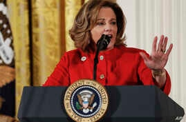 FILE - Deputy National Security Adviser K.T. McFarland speaks at the Women's Empowerment Panel, at the White House in Washington, March 29, 2017. Reportedly leaving President Donald Trump's national security staff, she is said to be in line to be the