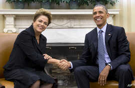 President Barack Obama and Brazilian President Dilma Rousseff shake hands in the Oval Office of the White House in Washington, June 30, 2015.