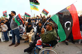 "Libyan protesters take part in a rally  in support of ""Fajr Libya"" (Libya Dawn), a mainly Islamist alliance, in Tripoli's central Martyr's Square, Feb. 13, 2015."