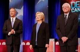 From left, Democratic presidential candidates Martin O'Malley, Hillary Clinton and Bernie Sanders stand together before the start of the NBC, YouTube Democratic presidential debate at the Gaillard Center in Charleston, S.C., Jan. 17, 2016.