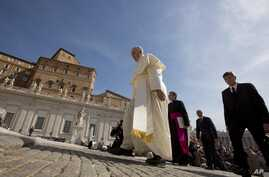 Pope Francis is seen arriving in St. Peter's Square at the Vatican May 13, 2015.