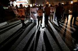 Supporters of Egypt's ousted President Mohammed Morsi chants slogans against Egyptian Defense Minister Gen. Abdel-Fattah el-Sissi during a march in Nasr City, JUly 30, 2013.