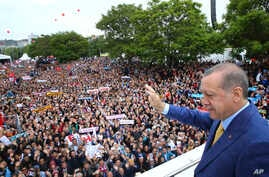 Turkey's President Recep Tayyip Erdogan waves to supporters as he arrives for a congress of the ruling Justice and Development Party (AKP) in Ankara, May 21, 2017.