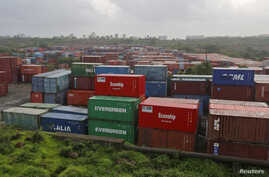 FILE - Cargo containers are seen stacked outside the container terminal of Jawaharlal Nehru Port Trust (JNPT) in Mumbai, India.