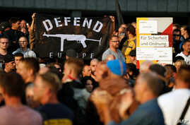 """People demonstrate on Aug. 27, 2018 in Chemnitz, eastern Germany, following the death of a 35-year-old German national who died in hospital after a """"dispute between several people of different nationalities,"""" according to the police."""