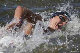 Rob Muffels of Germany competes in the men's 5km open water race at the Aquatics World Championships in Kazan, Russia, July 25, 2015. A recent British study reports that researchers found participation in specific sports - including swimming - reduce