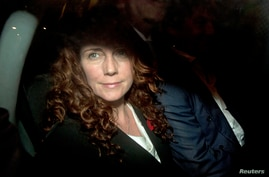 Former News International chief executive Rebekah Brooks leaves the Old Bailey courthouse in London, England, Oct. 30, 2013.