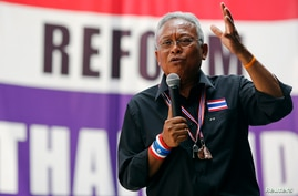 FILE - Protest leader Suthep Thaugsuban addresses anti-government protesters in their encampment in central Bangkok, Feb. 25, 2014.