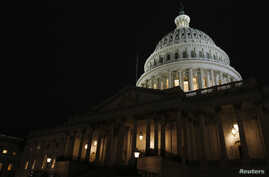 FILE - The U.S. Capitol building at night