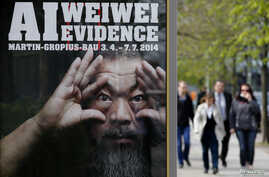 People walk beside an advertising poster for the exhibition 'Evidence' by Chinese artist Ai Weiwei at the Martin-Gropius Bau in Berlin, April 2, 2014.