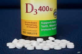 """Vitamin D pills are displayed, Wednesday, Nov. 9, 2016, in New York. Doctors are warning about vitamin D again, and it isn't the """"we need more"""" news you might expect."""
