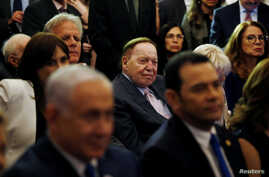 FILE - Sheldon Adelson, center, is seen during a reception at the King David Hotel, in Jerusalem, May 16, 2018.