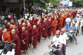 Burma Buddhist monks stage a rally to protest against ethnic minority Rohingya Muslims and to support Burma President Thein Sein's stance toward the sectarian violence that took place in June between ethnic Rakhine Buddhists and Rohingya Muslims, Sep...