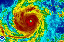 Super Typhoon Soudelor is seen in an enhanced infrared NOAA satellite image taken in the Western Pacific Ocean at 08:32 ET (12:32 GMT) August 4, 2015. Soudelor, deemed the strongest storm of 2015,