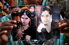 a family member shows pictures of slain fashion model Qandeel Baloch, in Shah Sadderuddin, Pakistan.