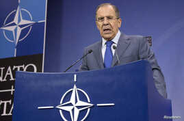 Russia's Foreign Minister Sergei Lavrov addresses a news conference after a NATO-Russia foreign ministers meeting at the Alliance headquarters in Brussels, Dec. 4, 2013.