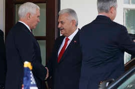 Vice President Mike Pence shakes hands with Turkish Prime Minister Binali Yildirim after a meeting at the White House, Nov. 9, 2017, in Washington.