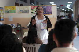 Patients participate in a Zika prevention talk as they wait to be attended to at the Women's National Hospital in San Salvador, El Salvador, Jan. 29, 2016.
