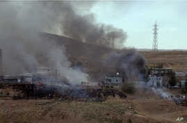 Smoke rises and fires still burn after Kurdish militants attacked a police checkpoint in Cizre, southeast Turkey,  Aug. 26, 2016, with an explosives-laden truck, killing several police officers and wounding dozens more.