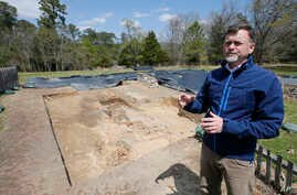 Historic Jamestown senior staff archaeologist David Givens gestures at the dig site of the Angelo slave house in Jamestown, Va., April 10, 2018.