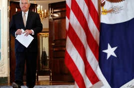 Secretary of State Rex Tillerson walks in to a news conference to speak about Qatar at the State Department in Washington, June 9, 2017.