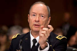 National Security Agency Director Gen. Keith Alexander testifies on Capitol Hill in Washington, Wednesday, Oct. 2, 2013, before the Senate Judiciary Committee oversight hearing on the Foreign Intelligence Surveillance Act. U.S. intelligence officials