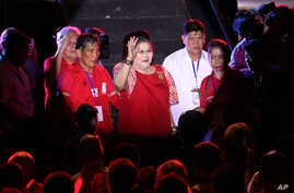 "Former first lady Imelda Marcos, center, waves to the crowd as she attends the last campaign rally of her son vice presidential candidate Sen. Ferdinand ""Bongbong"" Marcos Jr. at suburban Mandaluyong city, east of Manila, Philippines on May 5, 2016."