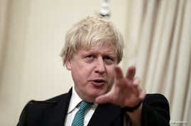 FILE - British Foreign Secretary Boris Johnson answers a question during a joint press conference with Greek Foreign Minister Nikos Kotzias (not pictured) following their meeting at the Foreign Ministry in Athens, Greece, April 6, 2017.