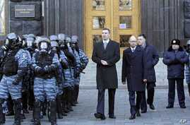 Lawmaker and chairman of the Ukrainian opposition party Udar (Punch), WBC heavyweight boxing champion Vitali Klitschko, centre left, walks with other opposition leaders Arseniy Yatsenyuk, centre, and Oleh Tyahnybok, centre right, as they could not ge