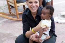 Soledad O'Brien with a baby at the Lighthouse orphanage in Port-au-Prince, Haiti