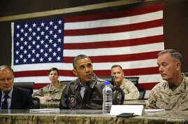 FILE - President Barack Obama (C) sits for a military briefing at Bagram Air Base in Kabul, Afghanistan, May 25, 2014.