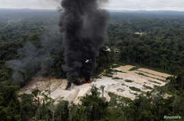 Machines are destroyed at an illegal gold mine during an operation conducted by agents of the Brazilian Institute for the Environment and Renewable Natural Resources,  in national parks near Novo Progresso, Brazil, Nov. 5, 2018.