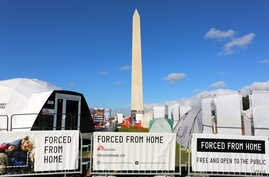 "The ""Forced From Home"" exhibit on the National Mall in Washington, D.C. depicts the life of more than 65 million displaced people worldwide (B. Allen/VOA)."