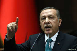 Turkey's Prime Minister Tayyip Erdogan addresses members of parliament from his ruling AK Party (AKP) during a meeting at the parliament in Ankara, Jan. 14, 2014.
