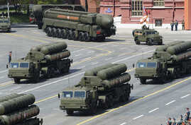 FILE - Russian S-400 surface-to-air missile systems are on displaye during a parade at Red Square in Moscow, Russia, May 9, 2015.