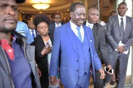 Raila Odinga, center, Kenya's opposition coalition and National Super Alliance (NASA) leader, walks out after a press conference in Nairobi at which the coalition has presented proof of alleged fraud in Kenya's August 2017 presidential election in wh