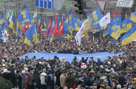 Demonstrators march and carry an EU flag during a protest in Kiev, Ukraine, Nov. 24, 2013.