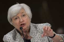 US Federal Reserve Chair Janet Yellen testifies before the Senate Committee on Banking , Housing, and Urban Affairs on Capitol Hill in Washington, DC, July 15, 2014.