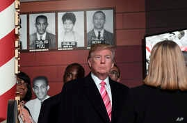 President Donald Trump gets a tour of the newly-opened Mississippi Civil Rights Museum in Jackson, Miss., Saturday, Dec. 9, 2017.