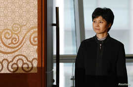 FILE - Former North Korean spy Kim Hyon-hui arrives at a meeting with Shigeo Iizuka and Koichiro Iizuka, family members of Yaeko Taguchi who was abducted by North Korea decades ago, before a news conference in Busan, March 11, 2009. Kim was sentenced