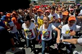 "FILE - Lilian Tintori, center right, wife of jailed opposition leader Leopoldo Lopez and Lopez's mother Antonieta Mendoza, center left, shout ""Freedom for Leopoldo"" during a rally in Caracas, Venezuela, Feb. 18, 2017."