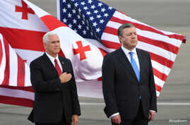 U.S. Vice President Mike Pence and Georgian Prime Minister Georgy Kvirikashvili attend a welcoming ceremony at the Tbilisi International Airport, Georgia, July 31, 2017.