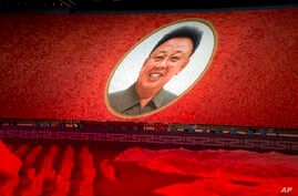 "A portrait of late North Korean leader Kim Jong Il is formed during the ""Glorious Country"" mass games held in conjunction with the 70th anniversary of North Korea's founding day in Pyongyang, North Korea, Sept. 9, 2018."
