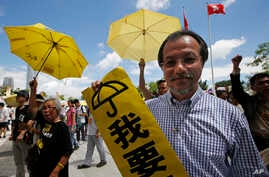 Pro-democracy protesters holding yellow umbrellas attend a rally outside the Legislative Council in Hong Kong, Wednesday, June 17, 2015.