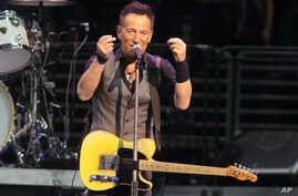 """FILE - Bruce Springsteen performs in concert with the E Street Band during """"The River Tour 2016"""" in Philadelphia, Feb. 12, 2016. Springsteen has canceled his concert in North Carolina, citing the state's new law blocking anti-discrimination rules cov"""